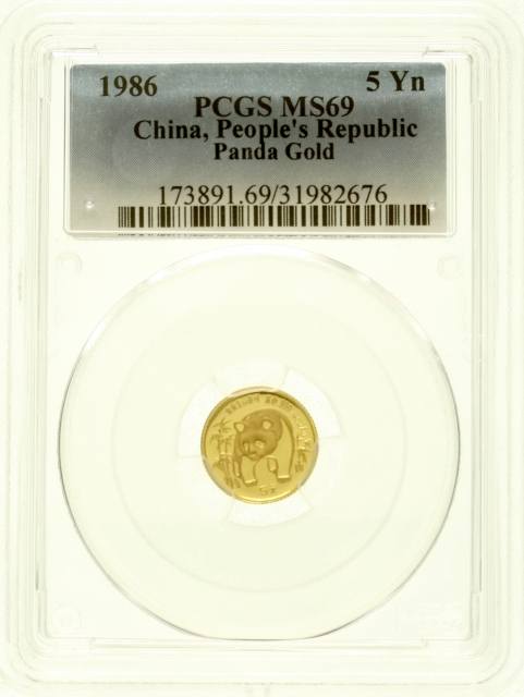5 Yuan GOLD 1986. Panda between bamboo plants. 1 / 20 oz fine gold.In the PCGS-Blister with Grading