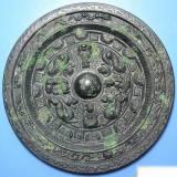 汉代黑漆古西王母龙虎镜