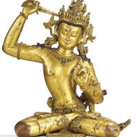 玛拉皇朝十四世纪尼泊尔鎏金铜文殊菩萨坐像