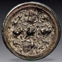唐银壳孔雀海兽葡萄镜