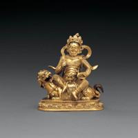 清康熙 铜鎏金财宝天王骑狮坐像