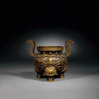 清乾隆 铜鎏金兽面纹三足香炉