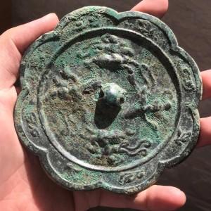 唐葵口仙人铜镜交易价格