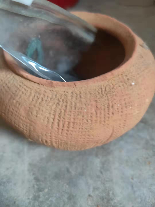 汉代红陶印花罐鉴定结果