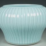 这件康熙天蓝釉菊瓣尊为什么就是假的呢